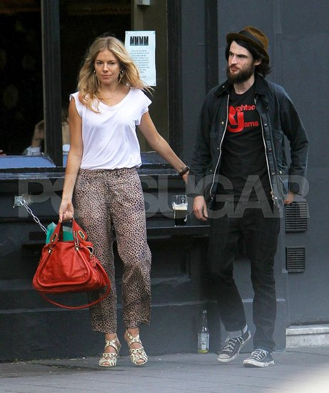 Sienna Miller held onto Tom Sturridge.