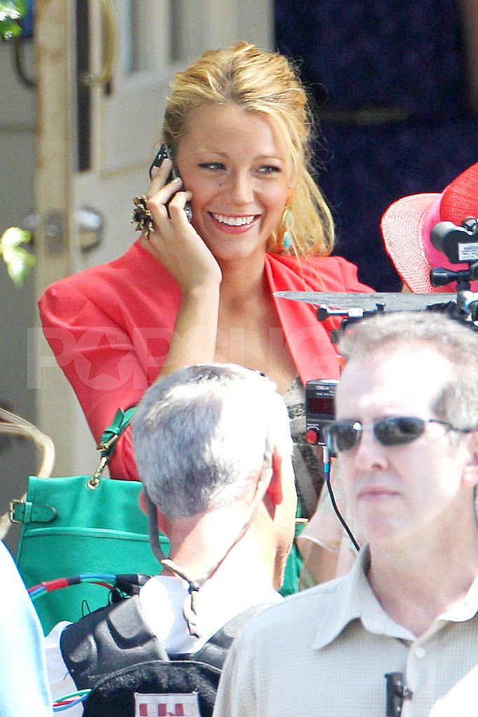 Blake chatted on her phone between scenes.