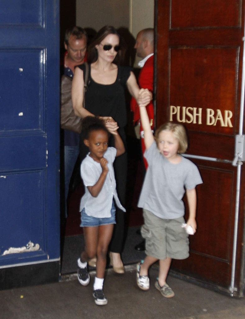 Angelina Jolie held onto Shiloh and Zahara's hands on the way out.