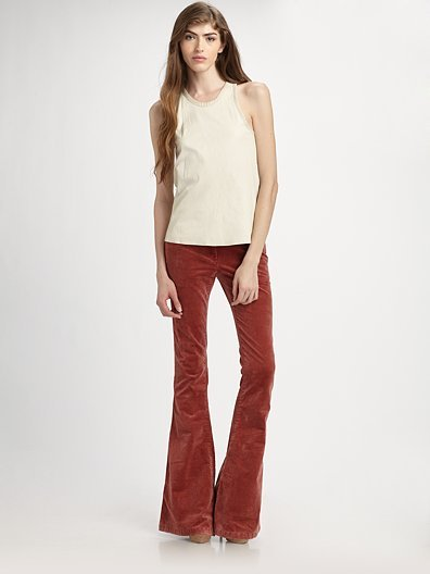 Theory Lindin Lamb-Leather Racerback, $575; Theory Crushed-Velvet Bell Bottom Pants, $255