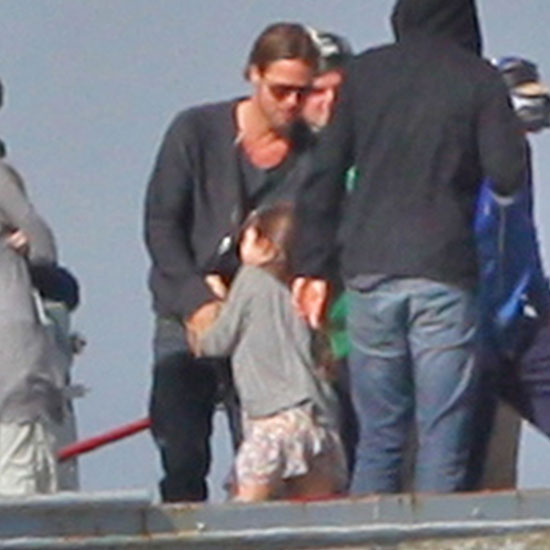 Brad Pitt dances with a young costar.