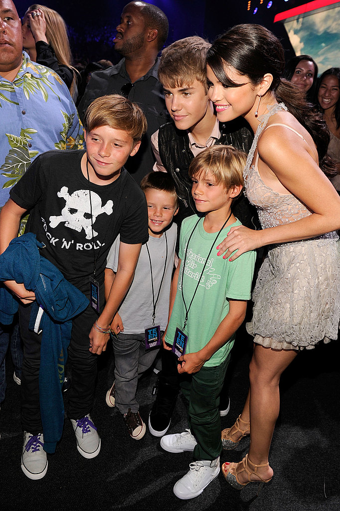 Justin Bieber and Selena Gomez pose with Brooklyn, Cruz, and Romeo Beckham.