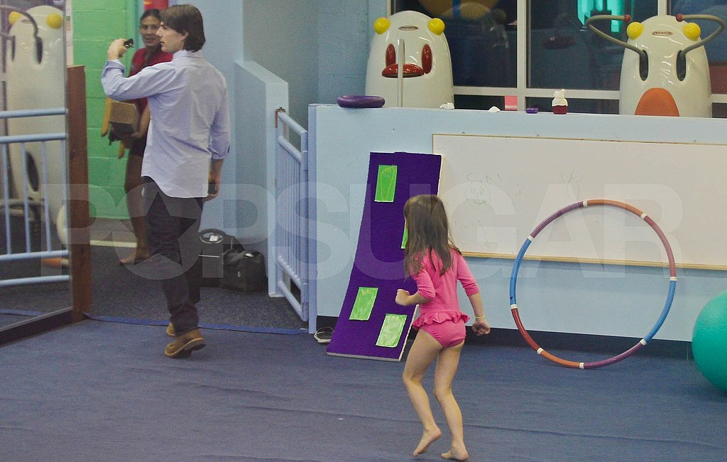Tom Cruise takes Suri Cruise to gymnastics.