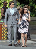 Hugo Becker in a slick gray suit and newcomer Roxane Mesquida wearing a Valentino floral print satin dress.