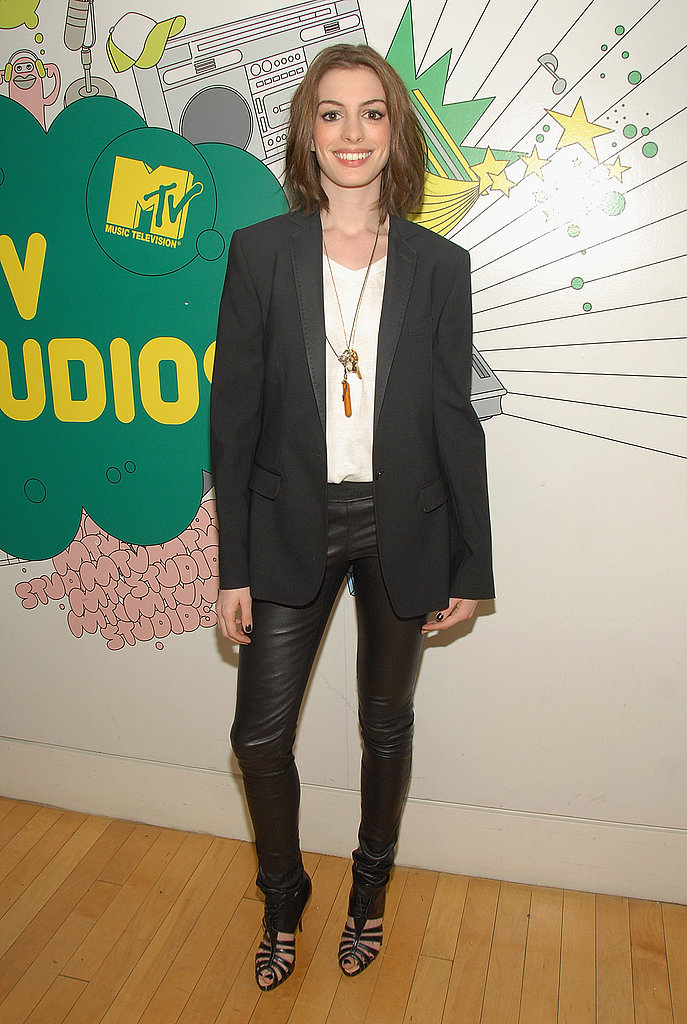 Trying on an edgier look for a visit to TRL in June 2008, but it sure beats her white suit look from years ago.