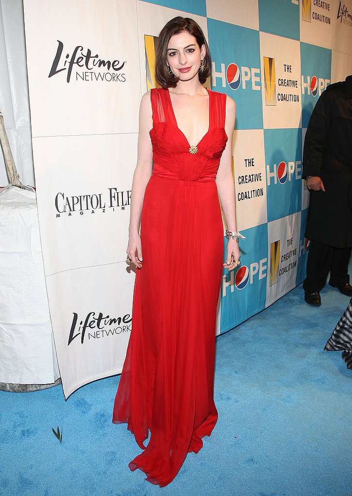 Calling to mind a vintage screen siren in red for an event in 2009; red is one of Anne's signature colors.
