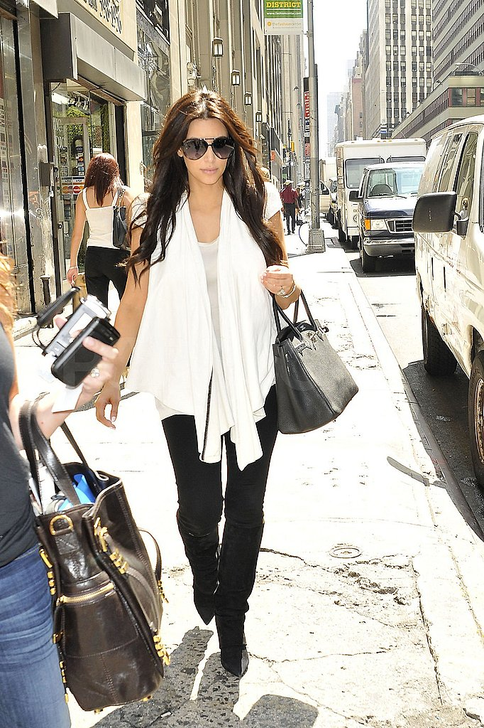 Kim Kardashian dressed in black and white for her cross-country trip.