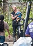 Ryan Gosling looks like a natural on set with a baby in his arms.