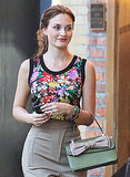 Leighton looked ladylike in her floral top.