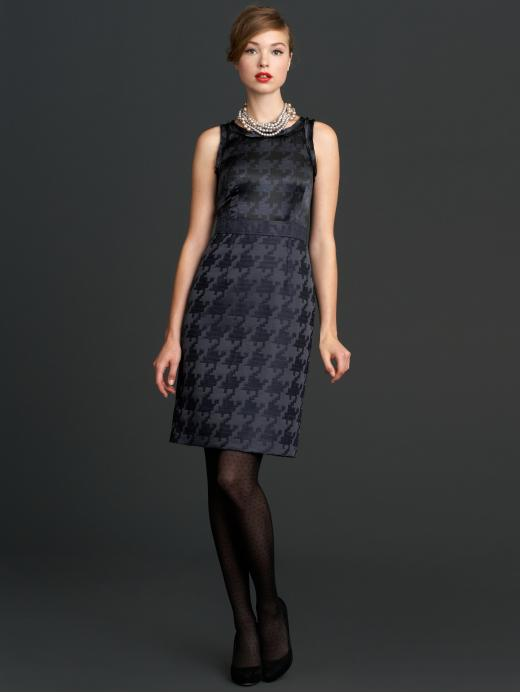 This classic sheath dress can be easily worn to the office with pumps and transformed later into eveningwear with high-heeled booties, layered jewels, and a pop of dark red lipstick.  Mad Men Collection Houndstooth Dress ($150)