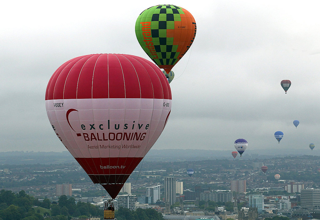 Balloons float over Bristol, England.