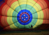 A rainbow-colored balloon prepares to lift off at the Bristol International Balloon Fiesta.