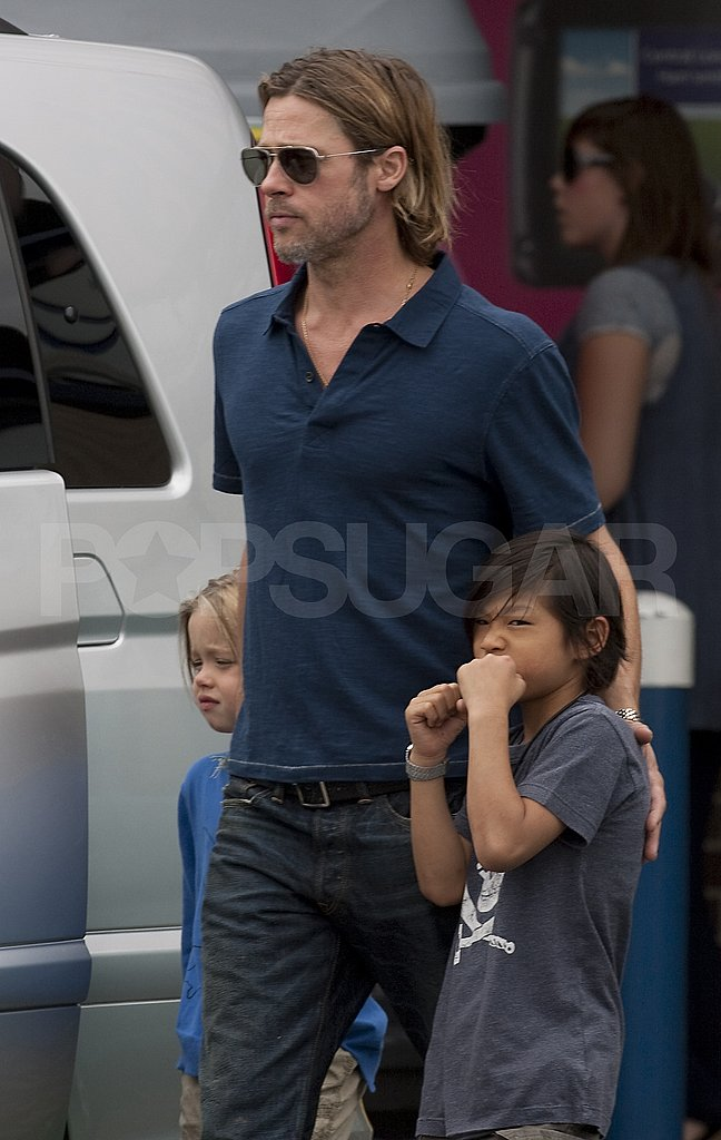 Brad Pitt with Shiloh and Pax.