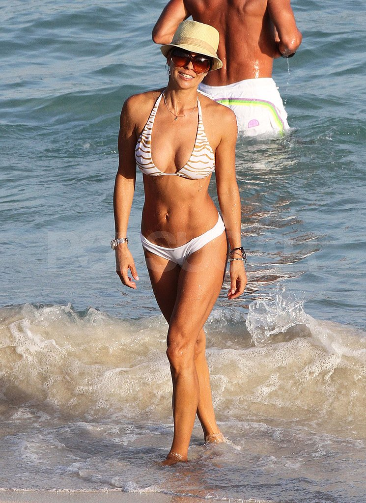 Brooke Burke in a white bikini.