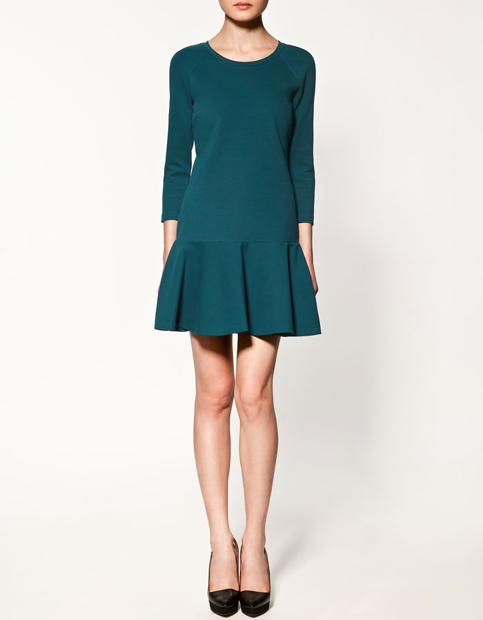 A drop waist detail in dark teal. Zara Flared Skirt Dress ($80)