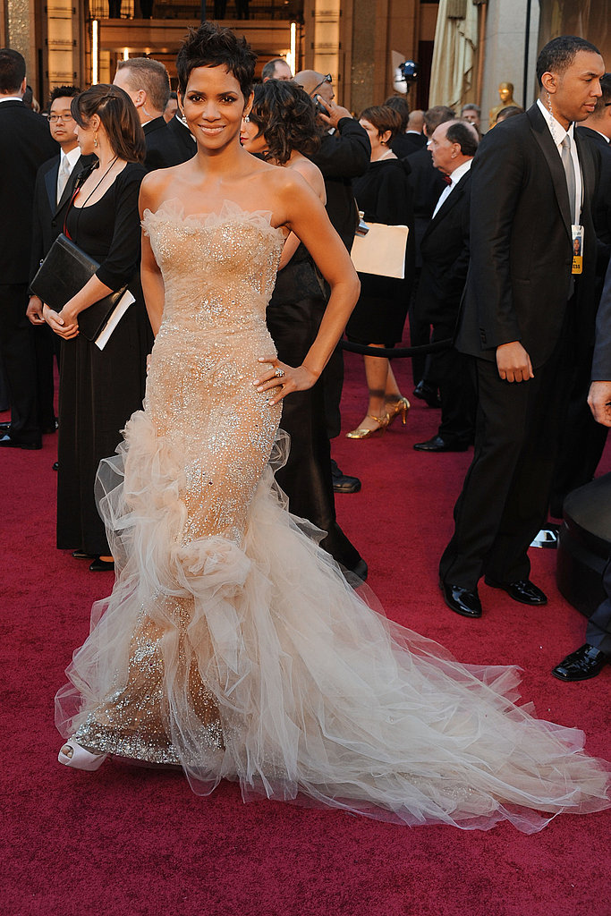 Reason 7: She can still indulge her girlier side in the most glamorous way possible — as evidenced by this nude Marchesa confection at the 2011 Oscars.