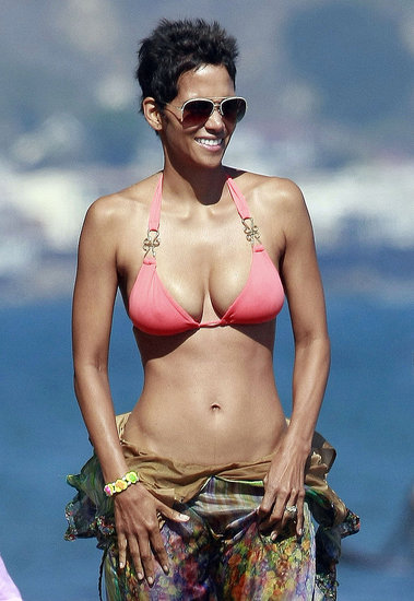 Reason 1: At 47, she looks better than any of us in a bikini.