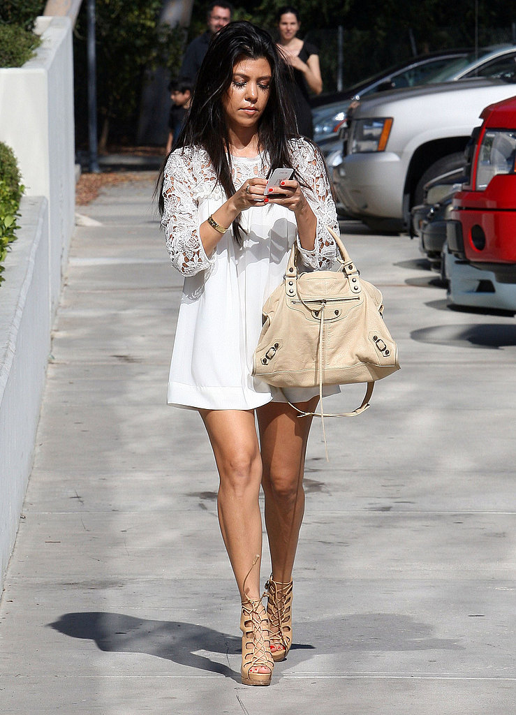 Kourtney Kardashian wore a white minidress.