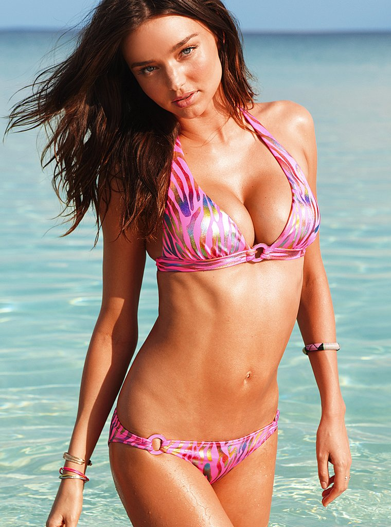 Miranda Kerr in a bikini on the beach.
