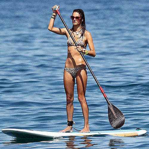 Alessandra Ambrosio paddleboarded in a bikini while in Hawaii in September 2011.