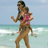 Adriana Lima wore a black bikini in July 2011 for a visit to Miami with her daughter, Valentina Jaric.
