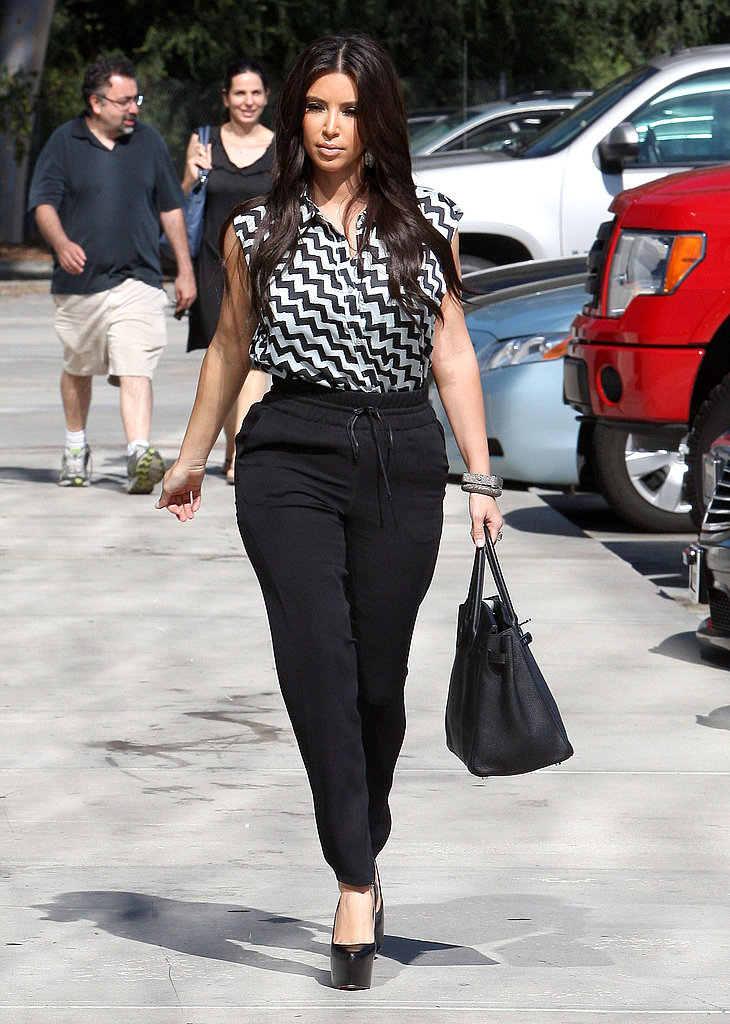 Kim Kardashian strutted through the parking lot.