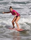 Christine Taylor surfing.