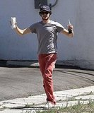 Adam Brody carried a bottle of soda.