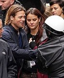 Brad Pitt smiles on the set of World War Z.