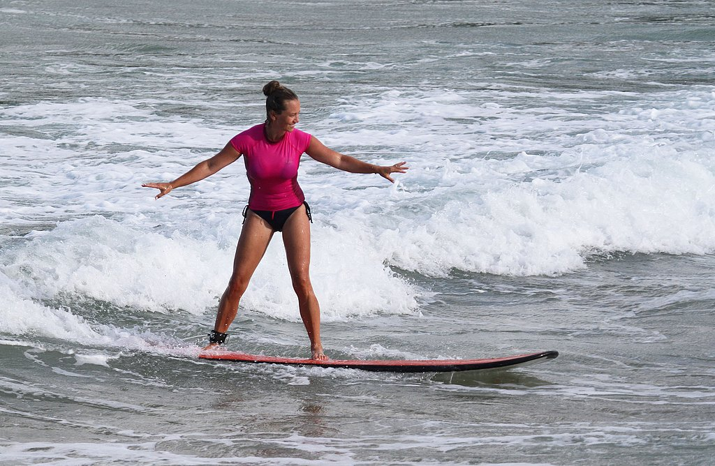 Christine Taylor surfing in Hawaii.