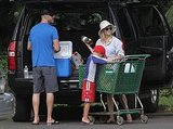 Deacon Phillippe, Jim Toth, and Reese Witherspoon unloaded their groceries.