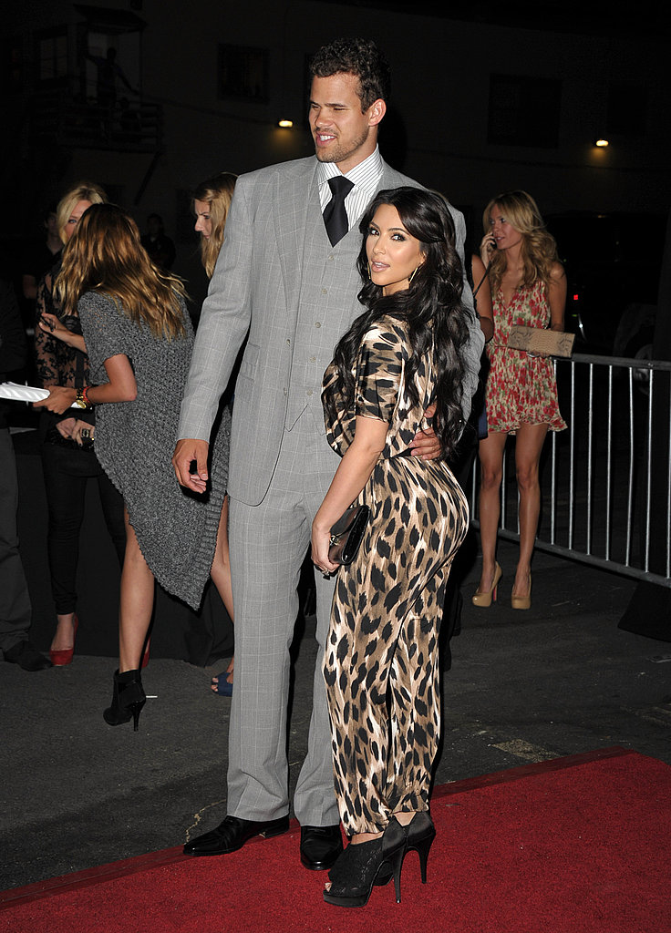 Kim Kardashian in leopard print with Kris Humphries.