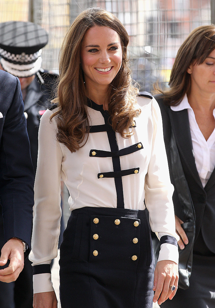 Kate Middleton smiles near Birmingham.