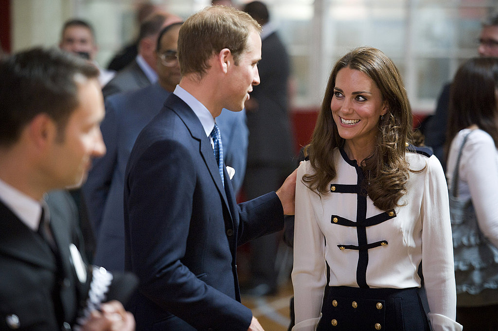 The royals exchange a sweet glance while carrying out official duties.