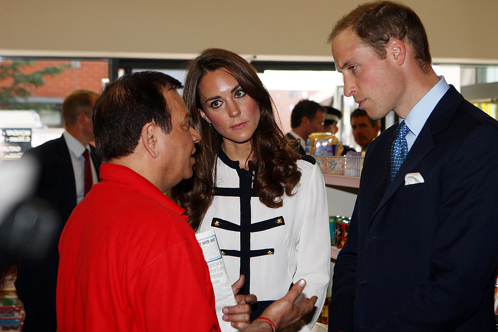 Prince William and Kate Middleton attend an event on Friday at the Machan Express Coffee bar in Birmingham, which was ransacked during the recent riots.