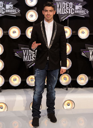 Joe Jonas worked the carpet ahead of the show.