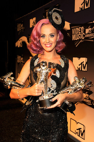 Katy Perry juggled her trio of awards.