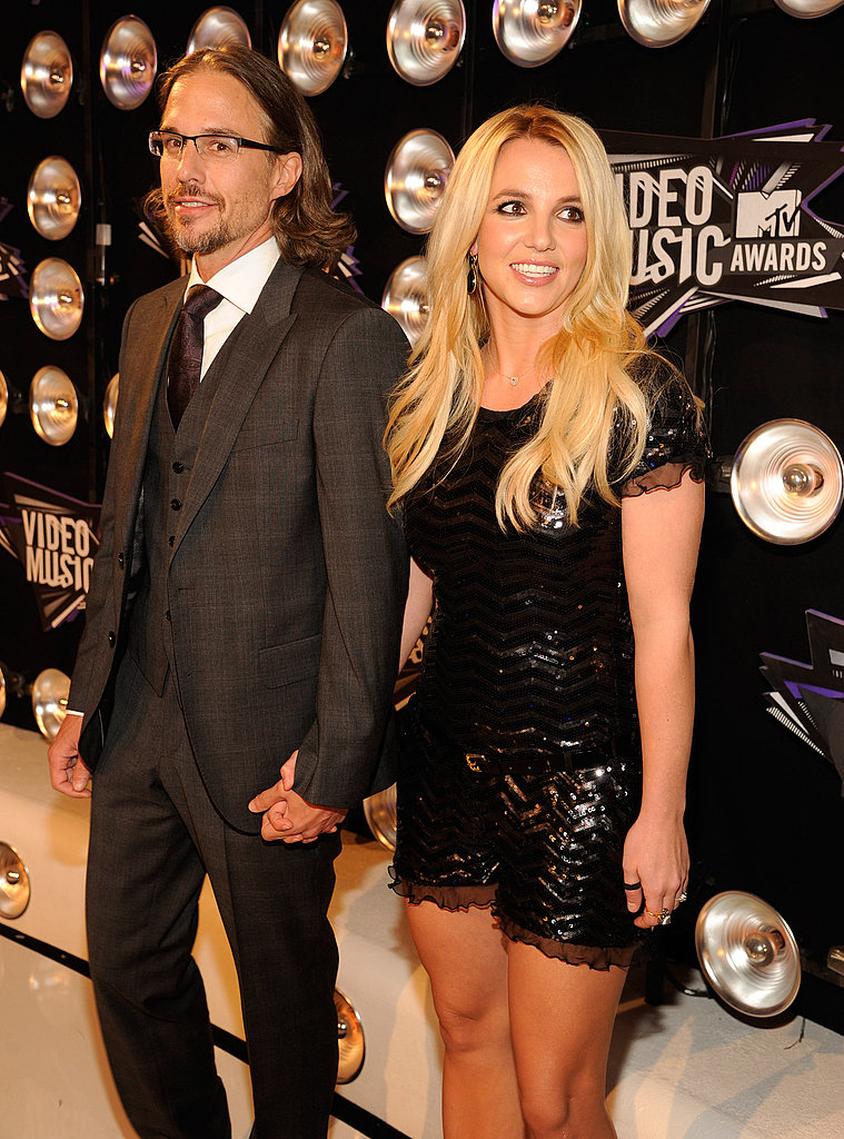 Britney and Jason hold hands tightly.
