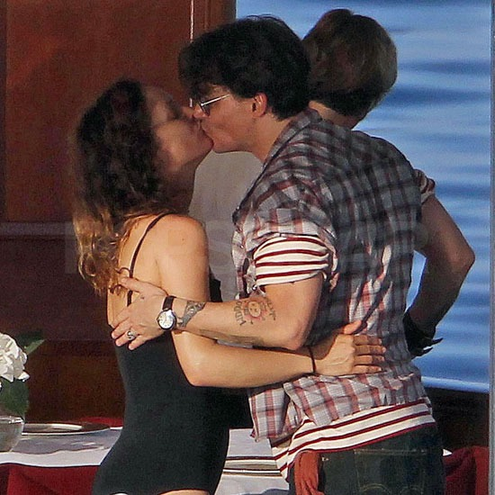 Johnny Depp and Vanessa Paradis shared a sweet kiss.