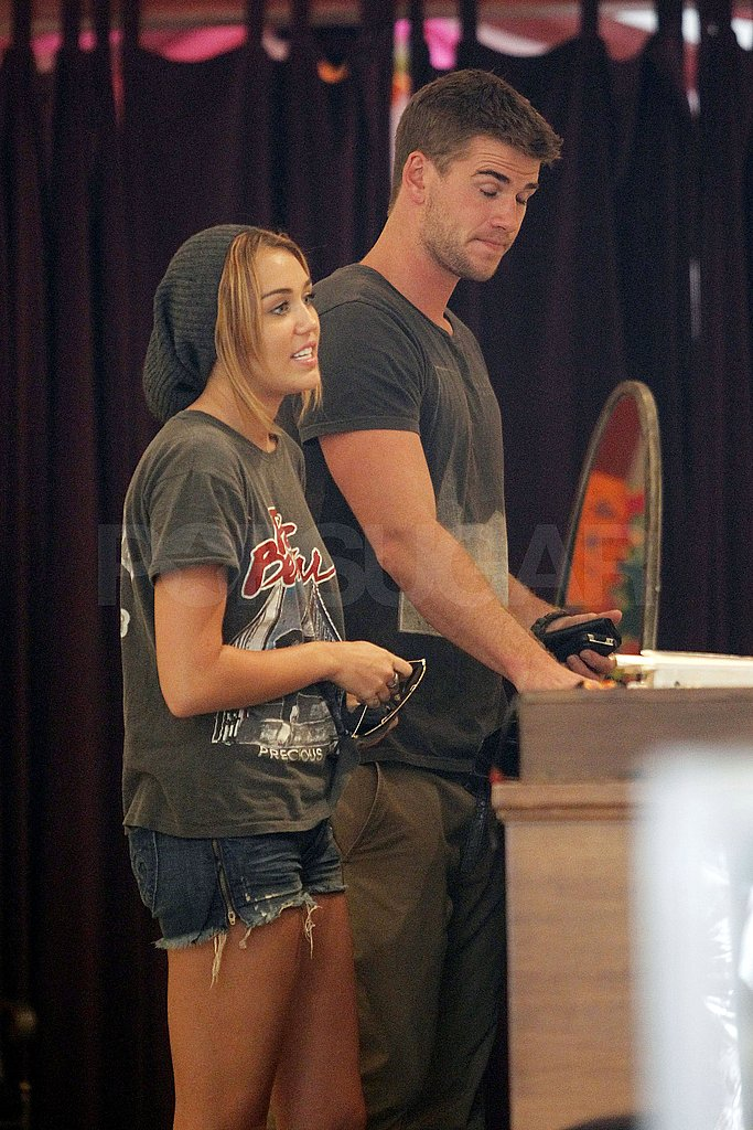 Liam Hemsworth escorted Miley Cyrus on a shopping trip.