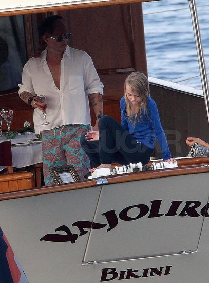Johnny Depp wore a wild pair of board shorts.