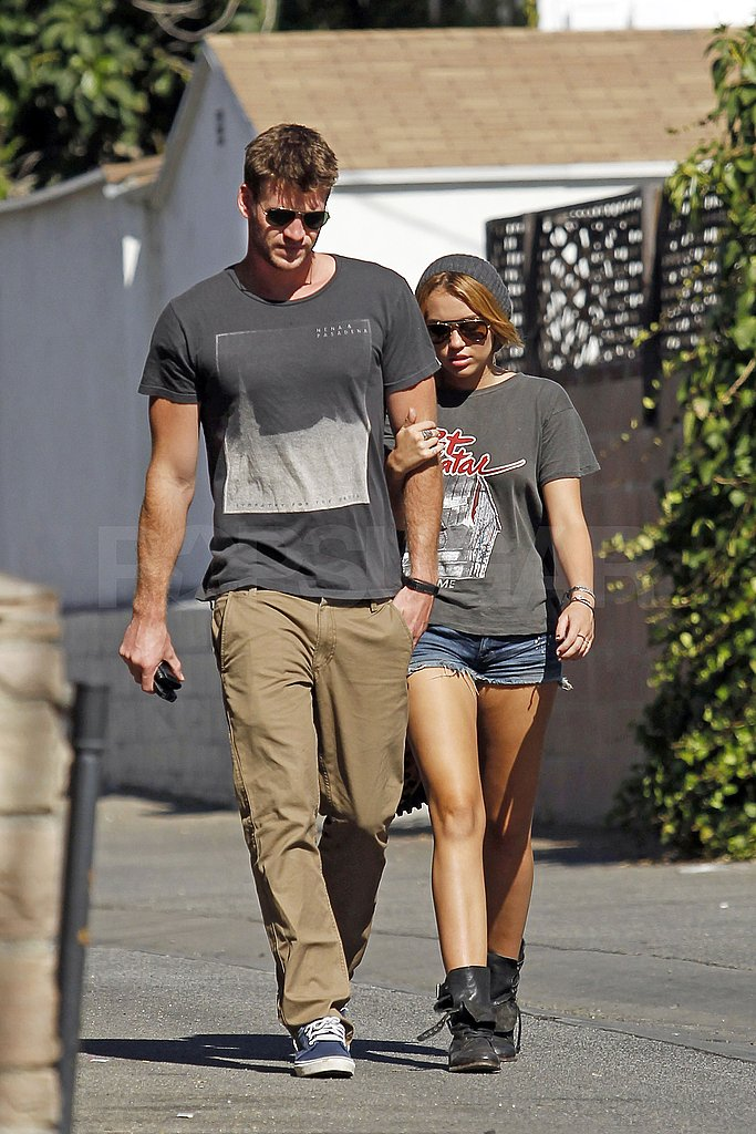 Miley Cyrus and Liam Hemsworth linked up leaving the jewelry store.