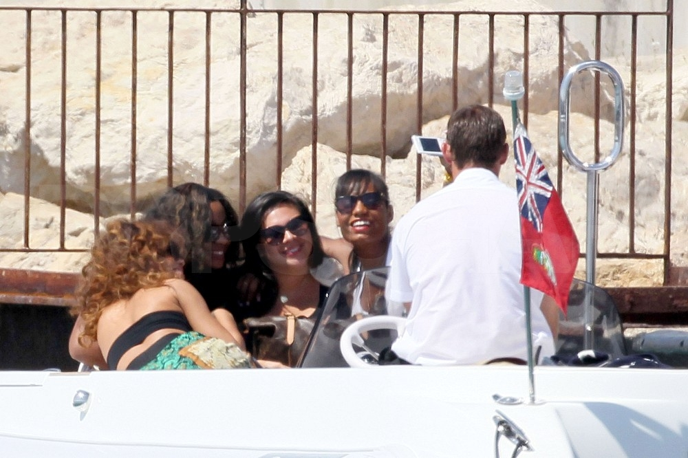 Rihanna posed for a photo with friends.