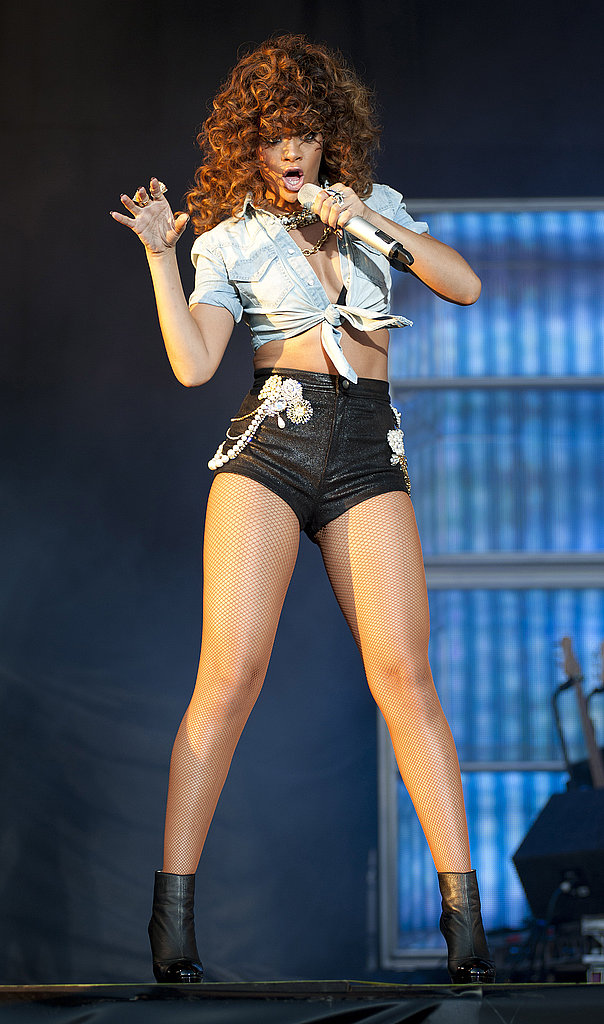 Rihanna wore black shorts and an ab-baring denim top.