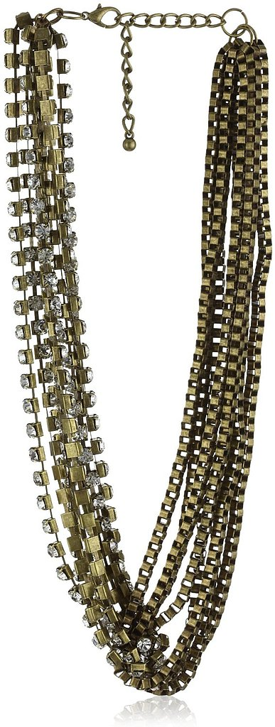 We love the mix of rhinestones, gold, and silver tones with an antique-feeling finish.   Leslie Danzis Crystal Box Chain Antique Gold Necklace ($90)