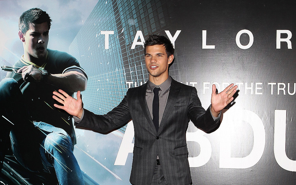 Taylor Lautner waved to fans.