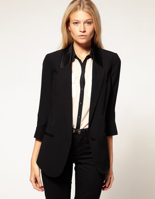 A streamlined black blazer with a cool contrast satin panel and cropped sleeves. Oasis Tux Jacket ($128)