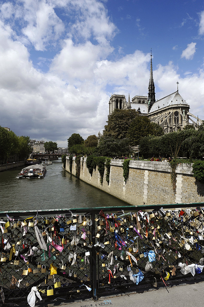 Love locks are affixed to the Pont des Arts bridge in front of the Notre Dame cathedral in Paris.