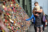 A couple embraces after affixing their lock to the bridge in Germany.