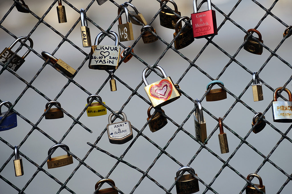 Love padlocks are decorated and affixed to a bridge in Paris.